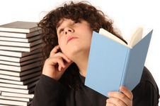 Free Boy Thinking And Reading A Book Royalty Free Stock Photo - 4692555