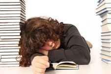 Boy Sleeping And And Many Books Royalty Free Stock Image
