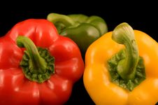 Red Yellow And Green Bell Peppers Stock Images