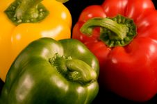 Red Yellow And Green Bell Peppers Stock Photos