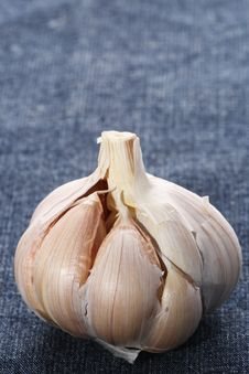 Free Single Garlic Bulb On Blue Fabric Background Stock Photos - 4698913