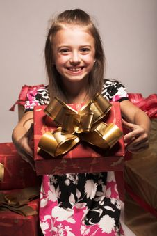 Little Girl And Xmas Presents Royalty Free Stock Images