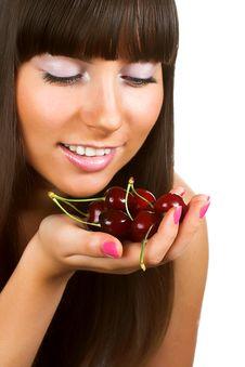 Brunette Holding Cherries Stock Photo