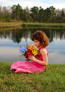 Cute Girl Holding Flowers Stock Image