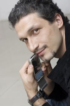 Romantic Smiling Man With Smartphone Royalty Free Stock Photo