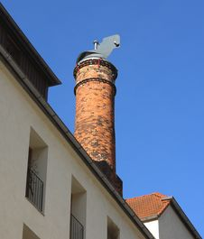 Brick Chimney On A Roof. Stock Photo
