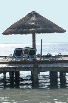 Free Umbrella And Beach Chairs Stock Photos - 4716723