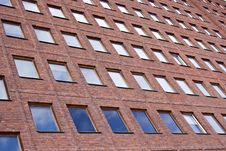 Free Front Of A Brick Building And A Nice Blue Sky Royalty Free Stock Photography - 4719957