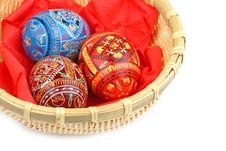 Three Russian Tradition Easter Eggs In Yellow Bask Royalty Free Stock Photos