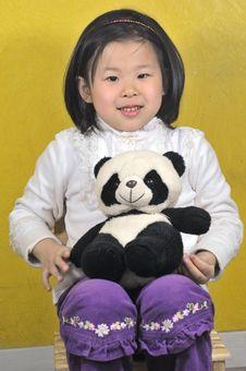 Girl With Panda Toys Stock Image