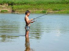 Free Boy Fishing With Spinning Stock Photo - 4721460