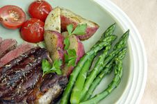 Free Steak With Potatoes, Tomatoes, And Asparagus Stock Photography - 4722892
