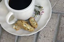 Free Cup Of Coffee With Biscotti And Flowers Stock Photography - 4723072