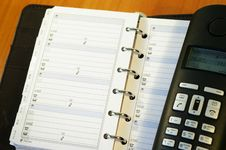Notebook And A Black  Telephone Royalty Free Stock Photography