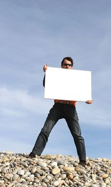 Free Young Man Holding White Card Stock Photo - 4725920