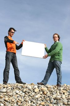 Free Two Young Men Holding White Card Stock Photo - 4725960
