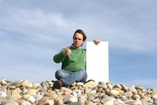 Free Young Man Holding White Card Stock Image - 4726051