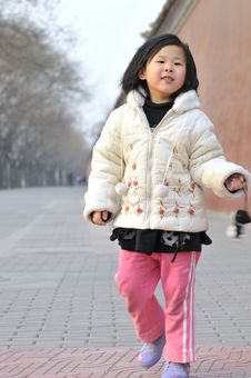 Free Chinese Girl In Front Of The Ancient Wall Royalty Free Stock Photo - 4730755