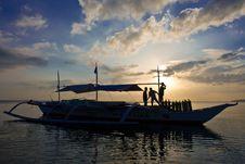 Free Unloading Banca Boat At Sun Set Royalty Free Stock Photography - 4734207
