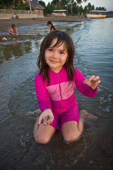Free Girl Finding Shells On The Beach Stock Photos - 4734293