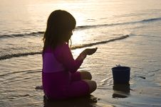 Free Girl Playing On The Beach At Sunset Stock Photography - 4734312