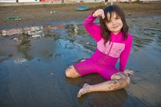 Free Girl Finding Shells On The Beach Royalty Free Stock Photography - 4734427