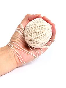 Free Hand Tied With Thread Stock Photo - 4735040