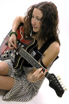 Free The  Girl Plays On A Guitar Stock Photos - 4738933