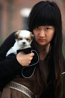 Girl And Baby Dog Stock Photography