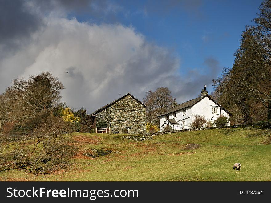 White farmhouse and stone barn