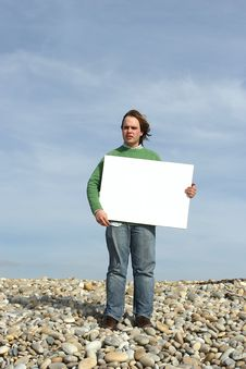 Free Young Man Holding White Card Stock Images - 4740194