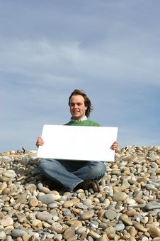 Free Young Man Holding White Card Royalty Free Stock Photography - 4740287