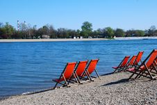 Orange Chairs By Water Royalty Free Stock Photo