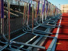 Free Running Track-Hurdles Along Fence Stock Image - 4749011