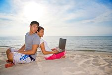 Free Couple Relaxing While One Of Them Working On The B Royalty Free Stock Photos - 4749208