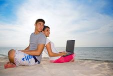 Free Couple Sitting On The Beach Relaxing Stock Photo - 4749250