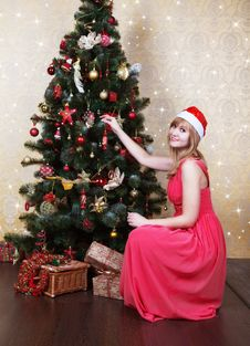 Free Young Beautiful Girl In Santa Hat Near Christmas Tree Royalty Free Stock Photography - 47483157