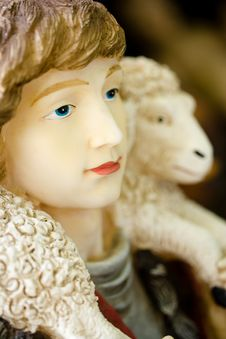 Nativity Figure Of Person And A Lamb Or Sheep Stock Image