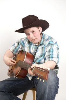 Free Young Cowboy Playing The Guitar Stock Photos - 4751793
