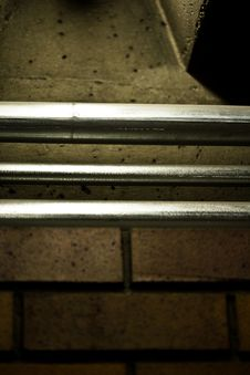 Free Close Up Of Metal Pipe Railings Against A Concrete Stock Image - 4752021