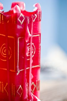 A Used Red Candle With Designs On The Side Royalty Free Stock Photos