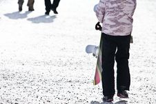 A Young Female Holding Her Snowboard And Walking O Stock Photo