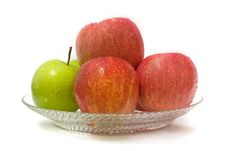 Green Apple Among Red Apple Royalty Free Stock Images