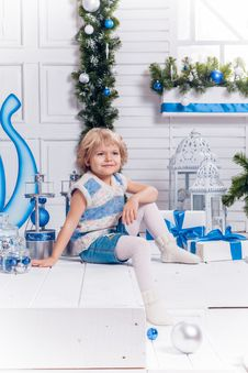 Free Little Smiling Pretty Girl Sitting Next To A Christmas Tree Stock Photos - 47589043