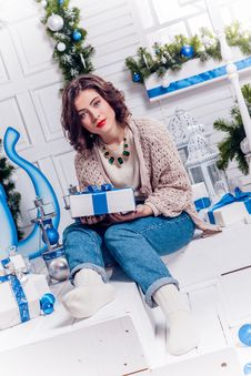 Free Pretty Young Girl In Jeans And A Cardigan With Christmas Gifts C Stock Photos - 47593043