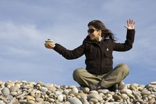 Free Young Casual Woman Holding Pile Of Round Stones Royalty Free Stock Photos - 4760928