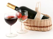 Wineglass With Red Wine And Strawberry Stock Photos