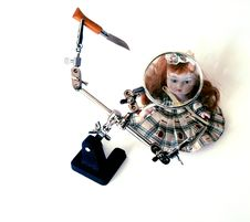 The Doll And The Knife Stock Images