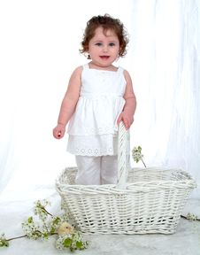 Free Smiling Little Girl In A Basket Royalty Free Stock Photography - 4762937