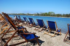 Free Blue Chairs By Blue Water Royalty Free Stock Photos - 4766608